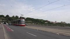 4K Pan right follow of tramway transit suburban area in Prague people commute Stock Footage
