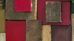 Close up top view of many old books. Pan Stock Footage