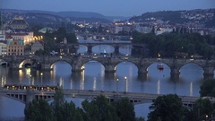 4K Aerial view heavy traffic people on Charles Bridge tramway cross Prague city Stock Footage