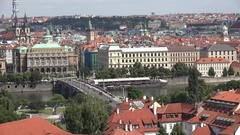 4K Aerial view Prague red rooftop building and ancient church tower traffic car Stock Footage