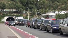 4K Bustling car on busy suburban street Prague tramway pass people commute jam Stock Footage