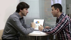 Two employees of the bank, are discussing business growth Stock Footage