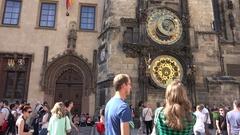 4K Tourist people enjoy take photo to Astronomical Clock Prague landmark emblem Stock Footage