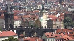 4K Aerial view crowd of pedestrian people walk on Charles Bridge Prague landmark Stock Footage