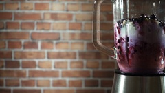 Blender with blackberry and kiwifruit milk smoothie on kitchen, slow motion Stock Footage