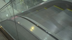 Moving escalator steps, escalator goes up at mall Stock Footage