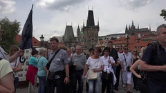 4K People crowd visit Charles Bridge in Prague tourism attraction emblem admire Stock Footage