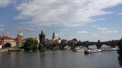 4K Timelapse touristic boat transportation in Prague Charles Bridge city symbol Stock Footage