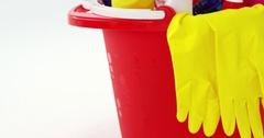 Various housekeeping supplies in a bucket Stock Footage