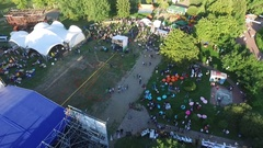 Festival at the amusement park, the view from the bird's-eye. People celebrate. Stock Footage