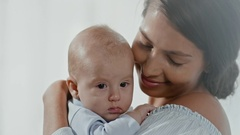 Affectionate Mother Cuddling Son Stock Footage
