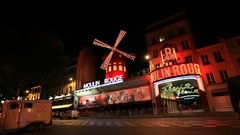 The Moulin Rouge cabaret at night Stock Footage