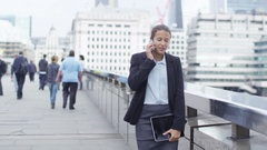 4K London businesswoman talking on cell phone outdoors in the city Stock Footage