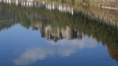 Bouillon castle reflecting in river, Belgium Stock Footage
