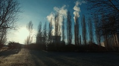 Smoke from factory chimneys over blue sky with bildings and trees. Industrial Stock Footage