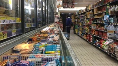 Consumer Buying Frozen Products In Supermarket Stock Footage