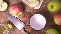 Slow motion of apple juice is poured into a metal cup of top view Stock Footage