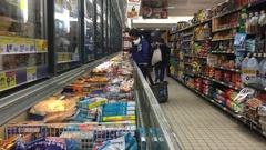People In Supermarket Frozen Section Stock Footage