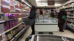 People Shopping In Grocery Store Refrigerators Section Stock Footage