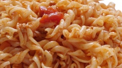 Served on plate close up spiral pasta Stock Footage