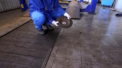 Mechanic hand showing worn rusty brake disk at garage Stock Footage