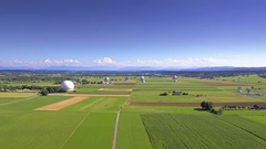 Beautiful field green grass parabolic satellite ground station antenna dish wide Stock Footage