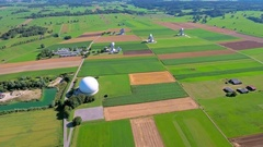 Aerial beautiful green fields parabolic satellite ground station antenna dish Stock Footage