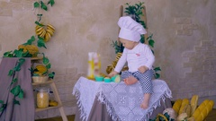 Kid, baby in cook cap playing with dough Stock Footage