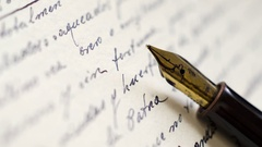 Close up of fountain pen on old letter Stock Footage