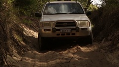 4x4 Vehicle driving down challenging sandy track Stock Footage
