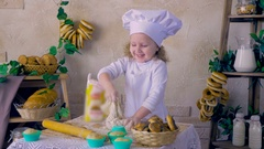 Little girl cook having fun playing with dough in kitchen decoration Stock Footage