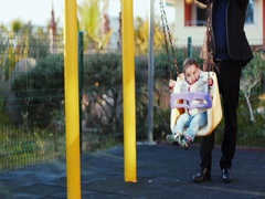 Father and child enjoy each other at the playground Stock Footage