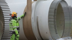 Worker Standing in Front of the Rotor Hub Stock Footage