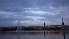4K Amazing Hamburg old town panorama at twilight Alster Lake water reflection Stock Footage