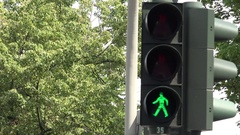 4K Unfocused traffic light change color red light to green allow people cross Stock Footage