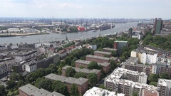 4K Aerial view industrial port of Hamburg busy harbor terminal container ship Stock Footage