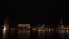 4K Beautiful Hamburg building architecture by night Alster Lake tourism emblem Stock Footage