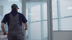 Repairman Checks the Office and Leaves Stock Footage