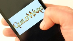 Popular computer games logotypes on smartphone screen Stock Footage