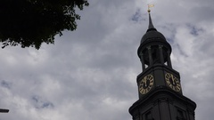 4K Famous Michel Church tower in downtown Hamburg town landmark icon cloudy day Stock Footage