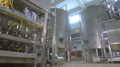 Pipes, storages, tanks in a industrial factory. Chemical, gas, oil, waterbio gas Stock Footage