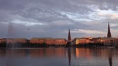 4K Amazing sunset at Hamburg orange light reflection on old building Alster Lake Stock Footage