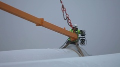 Worker Tying Rotor Blade With a Rope Stock Footage