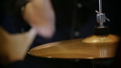 A closeup view of a hi hat cymbal played with a drumstick Arkistovideo