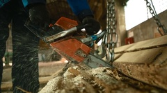 Man sawing boards at the sawmill Stock Footage