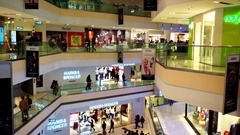 People shopping on multiple leves of a shopping mall in Delhi Stock Footage