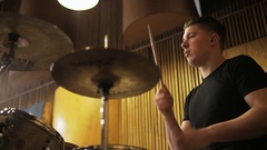 Percussionist Playing a Drum Set Seen From the Side Stock Footage