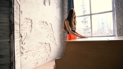 Young woman standing behind the white grand piano Stock Footage