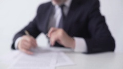 Mortgage broker signing papers, giving apartment keys to real estate buyer Stock Footage