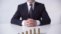 Banker looking at growing income from financial operations, lucrative investment Stock Footage